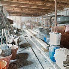 old barn storage room with light beams through window